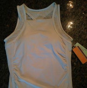 Women's white workout or yoga top shelf bra padded